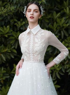 Couture Brautkleid mit transparentem Oberteil
